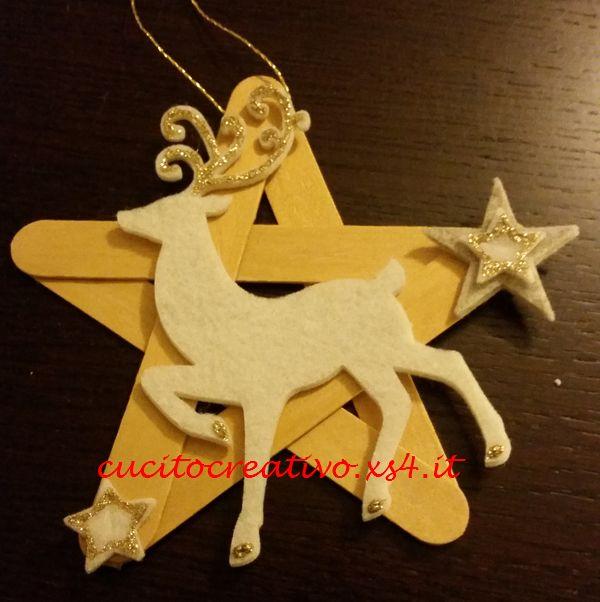 Stella oro natalizia con abbassalingua