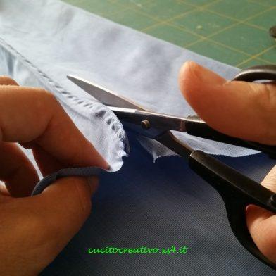 taglio manica con forbice